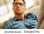 man relaxing in sofa at home ... | Shutterstock . vector #534364792