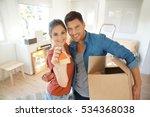 happy couple showing keys of... | Shutterstock . vector #534368038