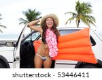 car rental: happy woman with pool raft car near the beach - stock photo