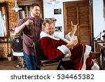 Santa Claus Shaving His...