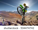 Professional dirt bike rider doing wheely - stock photo