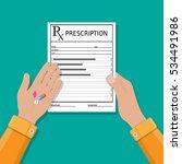 hands holds a prescription rx... | Shutterstock .eps vector #534491986