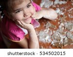 Small photo of Portrait of pretty little girl in white apron dreaming about a gift from Santa Claus for whom she bakes cookies by herself, happy family concept, winter holiday