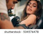 Tattoo Artist Creating A Tatto...