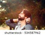 attractive man enjoying sun... | Shutterstock . vector #534587962