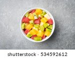 fresh fruit salad on gray stone ... | Shutterstock . vector #534592612