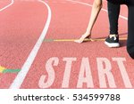 Athlete On Starting Line...