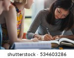 young woman taking notes from... | Shutterstock . vector #534603286