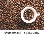 cup full of coffee beans on a... | Shutterstock . vector #534618382