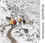 Small photo of Trekkers going to Everest Base Camp in snowstorm - Nepal, Himalayas