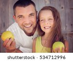 happy father with daughter... | Shutterstock . vector #534712996