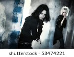 Two goth women at the columns. Contrast black and white colors. - stock photo