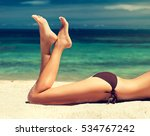 tanned well groomed feet amid... | Shutterstock . vector #534767242