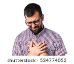 man with glasses with heart pain | Shutterstock . vector #534774052