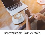 man using smart phone in cafe.... | Shutterstock . vector #534797596