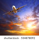 Small photo of passenger jet plane preparing to landing against beautiful dusky sky use for traveling and air transportation