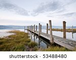 Jetty At Dusk With Prominent...
