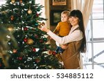 mom and son near christmas... | Shutterstock . vector #534885112