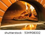 flaming hot wood fired pizza... | Shutterstock . vector #534908332