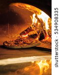 Flaming Hot Wood Fired Pizza...