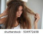 damaged hair. beautiful sad...   Shutterstock . vector #534972658