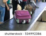 suitcase on luggage conveyor... | Shutterstock . vector #534992386