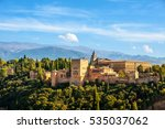Small photo of Granada, Spain. Aerial view of Alhambra Palace in Granada, Spain with Sierra Nevada mountains at the background during the sunny day