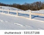 Wooden Fence On Winter Farming...