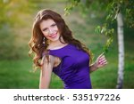 Young Woman In Purple Dress...