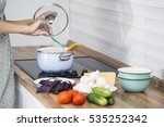 housewife cooking at the kitchen | Shutterstock . vector #535252342