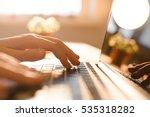 hands working on the computer... | Shutterstock . vector #535318282