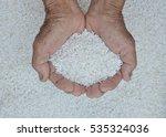 hands of farmer holding rice.... | Shutterstock . vector #535324036