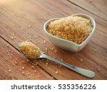 brown sugar in heart bowl shape ... | Shutterstock . vector #535356226