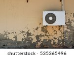 Small photo of Air compressor of the air conditioner on the vintage wall, background of air compressor