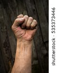 Small photo of The hand of an adult male clenched.