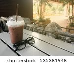 iced cocoa and glasses on table. | Shutterstock . vector #535381948