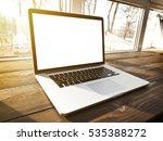 one modern laptop on hte window ... | Shutterstock . vector #535388272