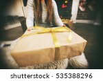 young woman keeps a paper gift... | Shutterstock . vector #535388296