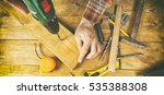 the carpenter works with wood... | Shutterstock . vector #535388308