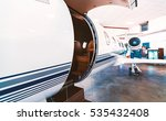 private jet with open door in a ... | Shutterstock . vector #535432408