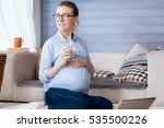 pregnant woman drinking water... | Shutterstock . vector #535500226