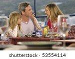 family enjoying in a restaurant | Shutterstock . vector #53554114