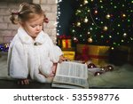 baby girl reading book with... | Shutterstock . vector #535598776