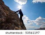 beautiful young woman climbing... | Shutterstock . vector #53561197