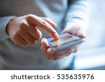 hand hold mobile phone with... | Shutterstock . vector #535635976