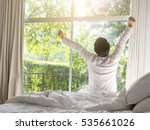 young man waking up and rise... | Shutterstock . vector #535661026