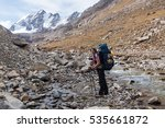 hiker relaxing at mountains ... | Shutterstock . vector #535661872