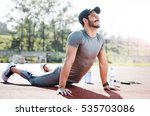 young man stretching muscles... | Shutterstock . vector #535703086
