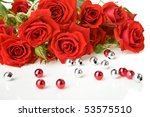 Stock photo red roses bouquet and beads on white background 53575510