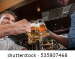 clinking beer glasses. two male ... | Shutterstock . vector #535807468